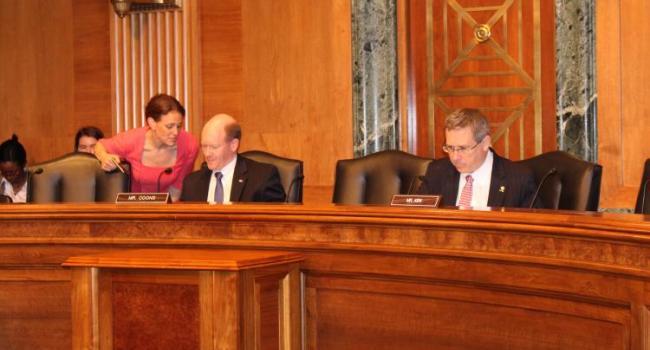 Senators Chris Coons and Mark Kirk.