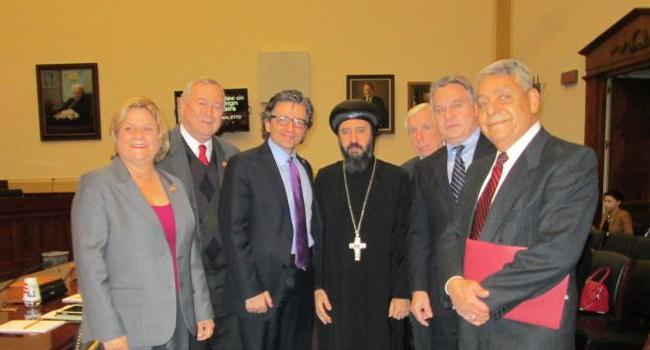 From left to right: Rep. Ros-Lehtinen, Rep. Rohrabacher, USCIRF Vice Chair Dr. M. Zuhdi Jasser, His Grace Bishop Angaelos, Rep. Wolf, Rep. Smith, and Professor Morad Abou-Sabe.