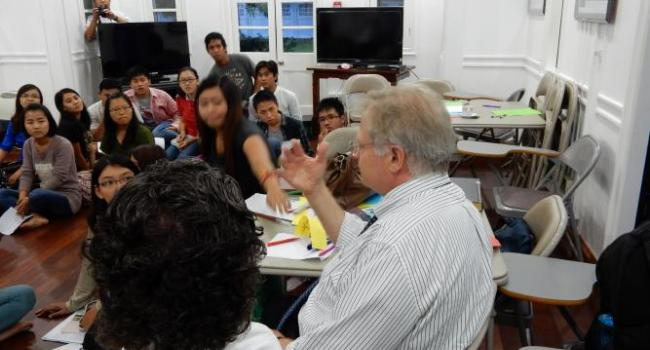 USCIRF Commissioners Eric P. Schwartz and M. Zuhdi Jasser speak with students at the U.S. Embassy Jefferson Center in Mandalay.