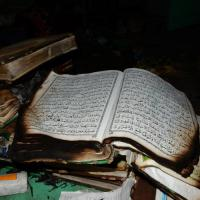 Burned Koran in a Mandalay cemetery during communal violence in July 2014.
