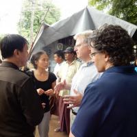 USCIRF Commissioners Eric P. Schwartz and M. Zudhi Jasser visit a camp for internally displaced Buddhists in Meiktila.