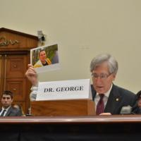 Vice-Chair Robert P. George holds up a picture of Saeed Abedini, an Iranian American Christian pastor who is currently imprisoned in Iran.