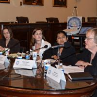 USCIRF Staff Tiffany Lynch and Sahar Chaudhry (both in center) at a Tom Lantos Human Rights Commission briefing on Human Rights Challenges Facing Syrian Refugees and Internally Displaced Persons, June 18, 2013