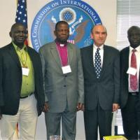 USCIRF Commission Elliott Abrams with Archbishop Okoh and other representatives of the Church of Nigeria Anglican Communion, August 2012
