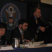 Commissioner Michael Cromartie at the podium
